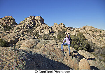 Female Hiking - a female hiking in the rugged granite dells...