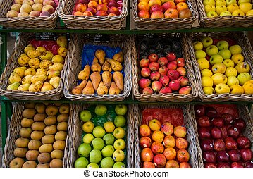 Fruits in baskets on market place