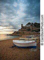 Fishing boats against Vila Vella fortress at Tossa de Mar