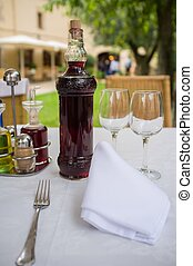 Table setting with bottle of wine in restaurant