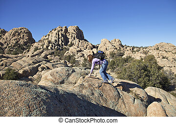 Hiking the Granite Dells - a woman hiking in the rugged...