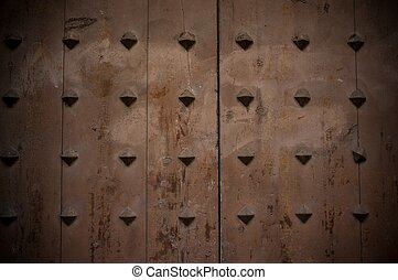 Old wooden background with metal knobs