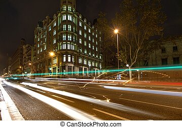 Street of Barcelona at night wtih blurred cars