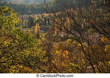 Small town view in autumn landscape