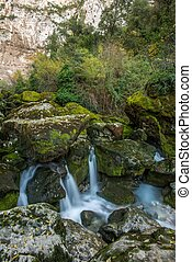 Stream running between rocks in Fontaine-de-Vaucluse, France...