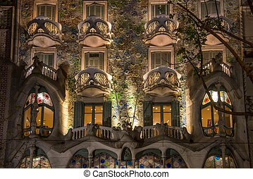 BARCELONA - NOVEMBER 24: Antonio Gaudi's famous Casa Battlo, illuminated at night, on November 24, 2012 in Barcelona, Spain