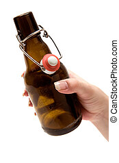 Holding a Bottle of Beer - Female hand holding an opened...