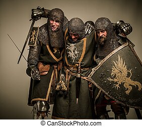 Two medieval knights carrying their buddy