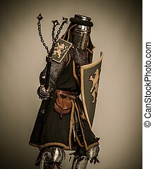 Medieval knight with mace and shield