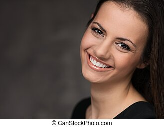 Young brunette woman with beautiful smile