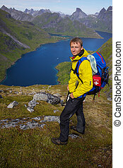 Backpacking on Lofoten - Young active man with backpack...