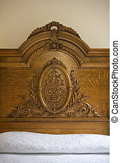 headboard, Rosewood Manor - A decorative wood headboard.