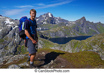 Young hiker in Norway - Young active man with backpack...