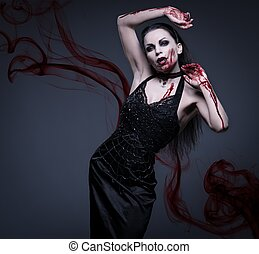 Beautiful vampire woman covered in blood