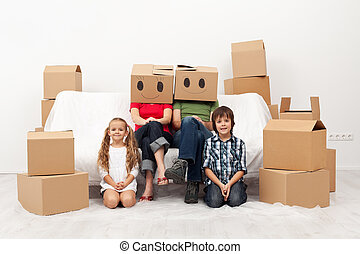 Family moving to a new home - sitting among cardboard boxes