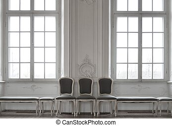 Three chairs standing near windows
