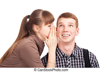 Young woman telling a secret to a man. Shot over white...
