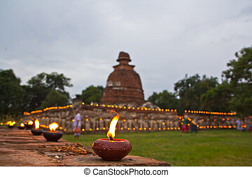 Vesak Bucha candle lit Old Thai temple in ayutthaya thailand