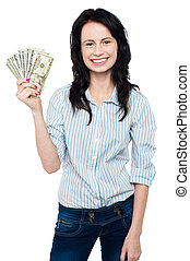 Attractive young woman holding money - Pretty woman holding...
