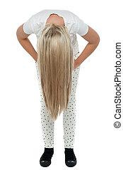 Girl with long hair bending down - Full length portrait of...