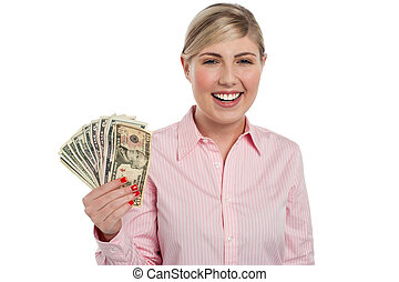 Pretty woman holding fan made of money - Attractive young...