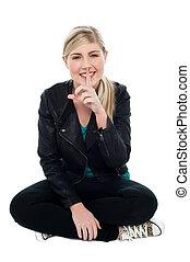 Cute blonde teen gesturing silence - Beautiful blonde in...