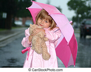 Happy Little Girl with Teddy Bear under Pink Umbrella...