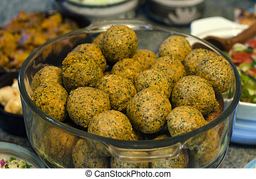 Falafel - a deep-fried ball or patty made from ground...