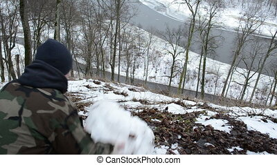 hill teen push snowball - young teenager boy man push...