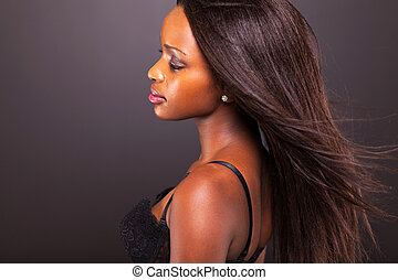 african american woman on black - pretty thoughtful african...