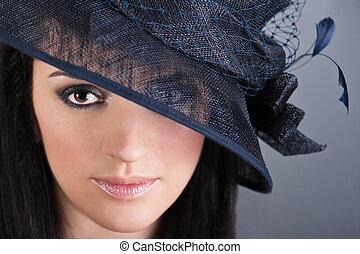 Beautiful woman in vintage hat