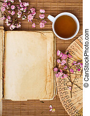 Old blank book with green tea - Old blank book with green...