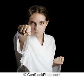 Girl throwing a karate punch - Young girl throwing a karate...