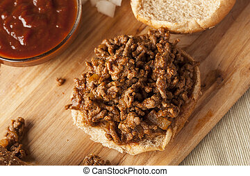 Sloppy Barbecue Beef Sandwhich on a whole wheat bun