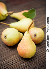 Organic pears on wooden background