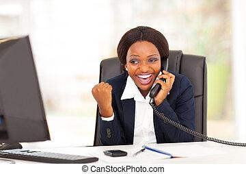 african businesswoman receiving news