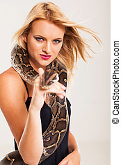 sexy young blonde woman with python