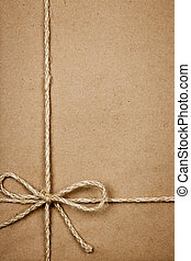 Package in brown paper tied with string - Brown paper gift...
