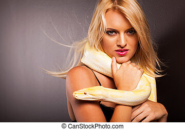 blonde woman holding python - attractive blonde woman...