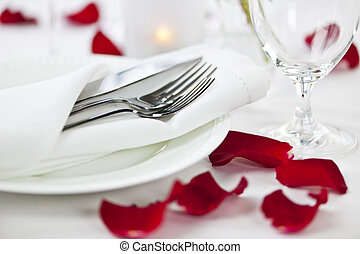 Romantic dinner setting with rose petals - Romantic table...
