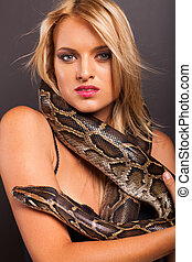 attractive young woman with python