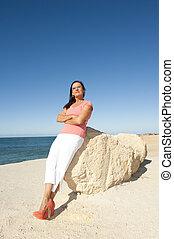 Confident attractive mature woman beach - Portrait confident...