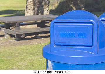Thanks for the trash - Blue plastic trash can in a clean,...