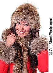 Portrait of a beautiful happy woman wearing fur