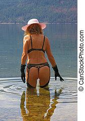 Watery Scenes 3 - Female fashion model wearing lingerie in a...