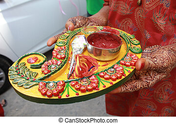 Mehendi Ritual Items - A decorated dish full of different...