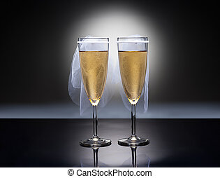 Champagne glasses with conceptual same sex decoration...