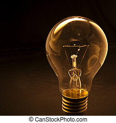light bulb with low key background conception for idea...