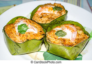 Steamed fish with curry paste - Thai food Ho Mok Pla or...