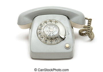 Grungy Old Telephone - Broken dirty phone. White background.